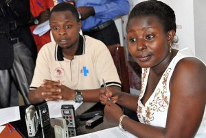 ANPPCAN research coordinator Ruth Birungi flanked by Information officer Maron Agaba at a news conference.