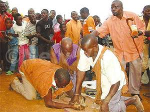 Herbalists carrying out an exorcism. Residents have lost millions to such scams