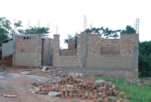"A house under construction. Some people believe they must make construction related rituals and sacrifices in a bid to appease ""gods"" and spirits."