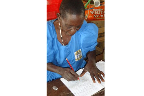 Joyce Atim tries out writing numbers recently.