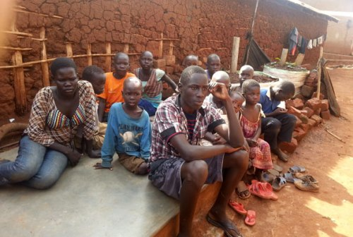 Makmot (3rd R) and other children in Kinawataka slums who are supported by AVSI.
