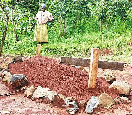 A woman stands by the grave where the body of man who was thought to be Gimugunyi was buried in January.