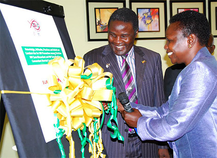 Ondoa launches the HIV report as Bishop Joshua Lwere looks on at Imperial Royale hotel Kampala in June this year