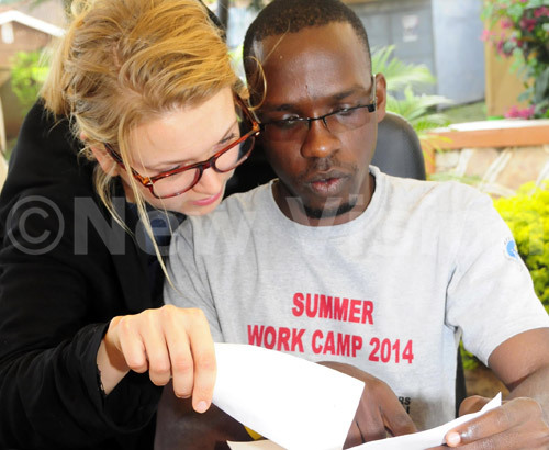 Alexandra Kraszkiewicz from Cultures of the World foundation talks to one of the youth leaders at Bwaise Youth Employment Center.