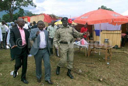 Imbalu organizing committee publicity, James Ingoi centre (L) Mbale RDC Shabani Kachimeti and Elgon subregion RPC Jacob Opolot inspecting the imbalu festival grounds in Mbale.