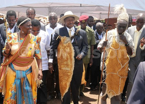 President Yoweri Museveni flanked by energy minister Irene Muloni (L) Umukuka, the Cultural leader of Bamasaba, Wilson Wamimbi Weyasa and other guests at the inauguration of the Bamasaba Imbalu (circumcision) festival 2014.