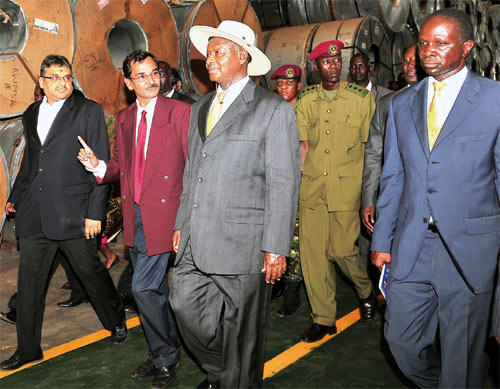 President Yoweri Museveni (centre) and offi cials of MM Integrated Steel Mills Uganda Ltd touring the factory in Jinja.