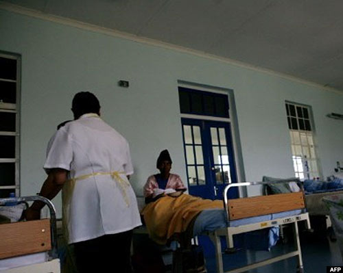 A nurse attends to a patient in hospital. WHO figures show that about 21 million people are infected with typhoid fever every year