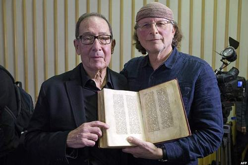 Here, they pose with a reproduction of what is thought to be a 6th century manuscript at the press conference