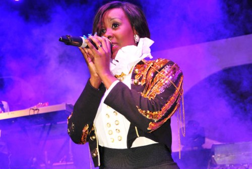 Ms Luzinda kneels before fans during a recent music show.