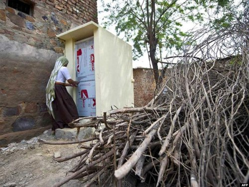 A village resident in Haryana state uses a toilet constructed by an NGO (Sulabh International)