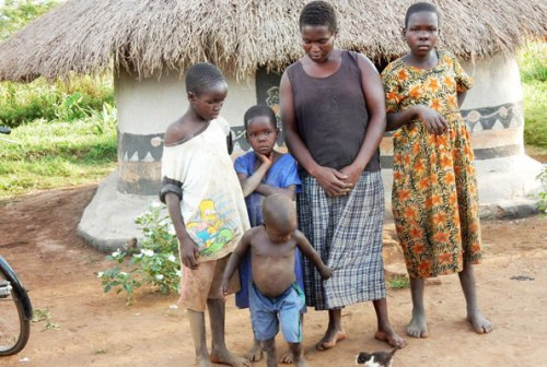 Ms Dorcus Aceng with her children in Apac District. Despite change of environment, the children are still confused and upset.
