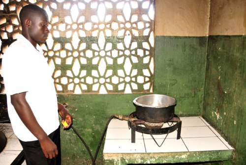 Above, a stove at Kansanga Primary School. The stove uses bio gas produced from a bio latrine using human and animal waste.