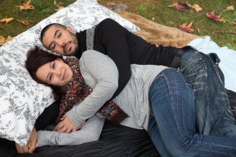 Professional cuddler Samantha Hess relaxes with Portland musician KaiKani Seven Vanity.
