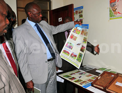 State minister Bright Rwamirama inspects the new office opened to help fight tsetse flies at Dokolo district.