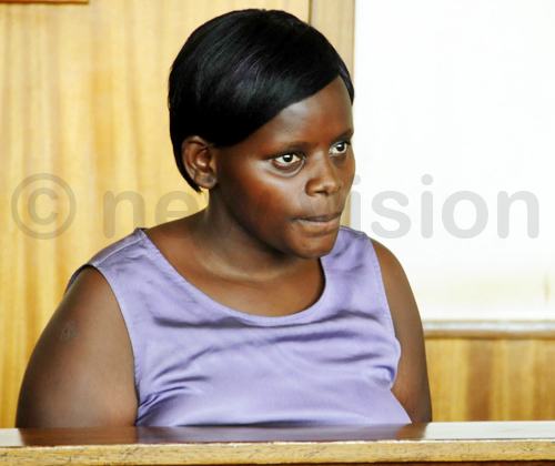 Jolly Tumuhiirwe listens intently as she is sentenced at Buganda Road Court.
