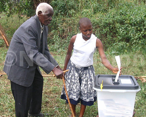 Sub-Saharan Africa, did not benefit from the upward trend. Here, an elderly Ugandan man is helped by a girl to cast his vote