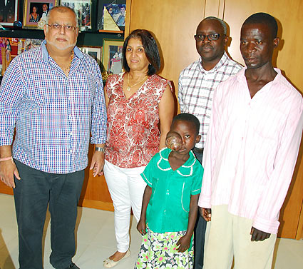 Litttle Gloria with her dad met the Ruparelias and Vision Group CEO Robert Kabushenga in Kampala.