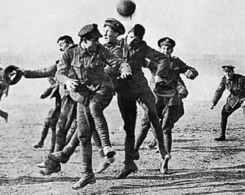German and British soldiers playing football on Christmas Day during WWI in 1914