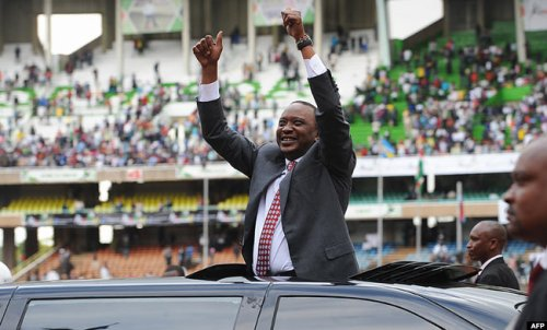 resident Uhuru Kenyatta arrives at the Kasarani stadium in Nairobi last year during celebrations marking half a century of independence from Britain
