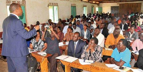 Minister for higher education John Muyingo addressing teachers in Mukono district