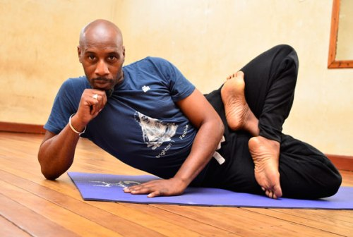 Pablo Imani strikes a yoga pose. Borrowing from the teachings of Egyptian Yoga, he developed Afrikan Yoga.