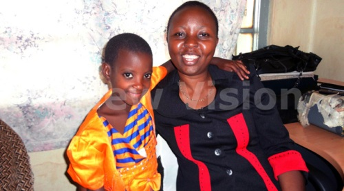 Carolyne Kushemererwa at Kawempe Police with an abandoned child