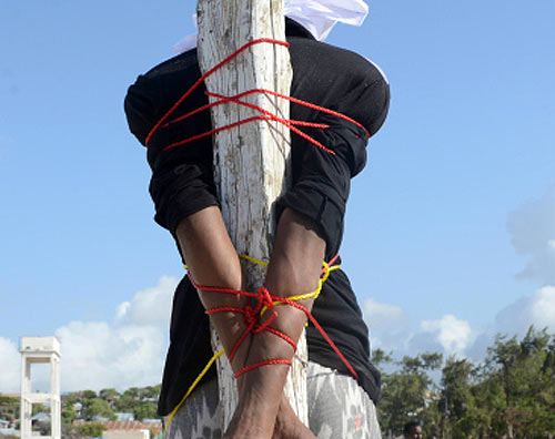 A convicted murderer is tied to a post before execution by firing squad in Somalia. (AFP/Getty Images)