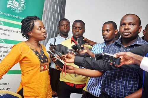 The executive director of Anti-Corruption Coalition Uganda, Cissy Agaba addressing participants during the release of MPs survey on money and politics at Hotel Africana in Kampala on January 27, 2015.