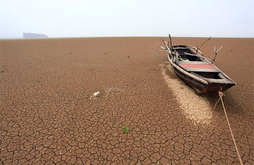 A boat lies stranded on the cracked bed of a dry area of Xieshan in 2011. (Reuters)