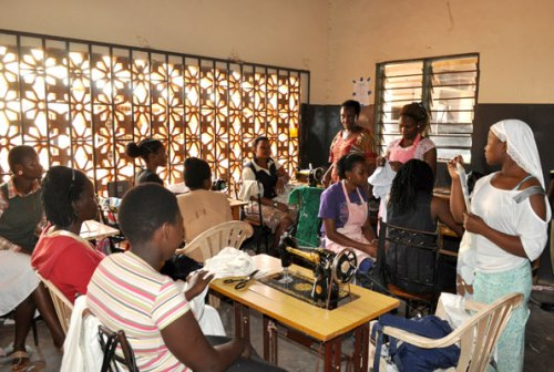 Students of tailoring listen to their instructor at Mirembe Vocational Institute in Zana, Wakiso District.