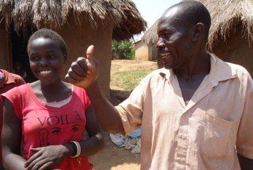 Mr Awali Tezikuba and his daughter at their home at Bufulubi village in Mayuge District yesterday.