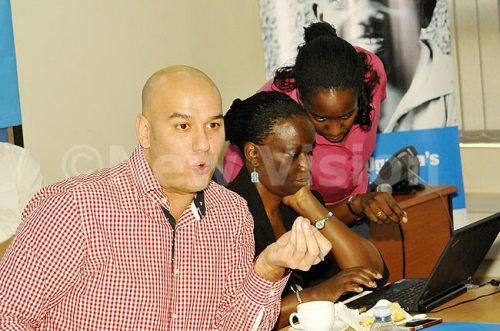 UNICEF's Chief Communication  partnerships youth engagement Jaya Muuthy addresses journalists in Kampala. Centre is Commun ication officer Agnes Barongo  and the Communication for Development Specialist Mariam Lwanga (R).