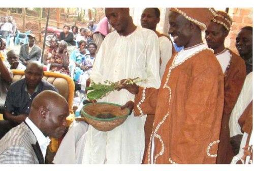 The President of the Uganda Traditional Healers Association, Uganda Neddagala Lyayo, Mr Jimmy Patrick Mudhungu, kneels down to receive blessings from Kitezi based traditional healers last Saturday.