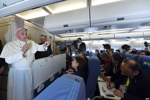 Earlier, on the papal plane on Sunday, Pope Francis said Christians should not breed like rabbits