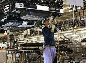 A worker assembles a Lexus car at the Toyota plant in Miyata City, Fukuoka Prefecture, Japan