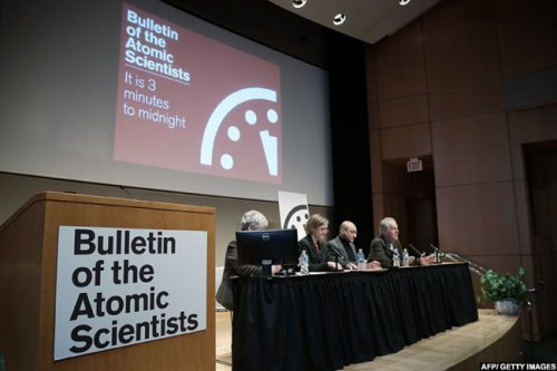 Scientists from the group Bulletin of the Atomic Scientists speak during a press conference on Thursday