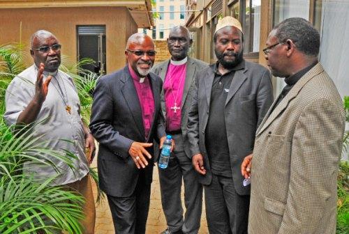 Fr Gaetano Batanyenda, Bishop Zac Niringyiye, Bishop Macleod Baker Ochola, Sheikh Muhammad Katuramu and Rev Canon Francis Mutatiina chat after a press conference in Kampala yesterday.
