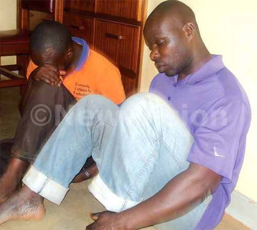 The men who castrated Ssekiranda in handcuffs after their arrest