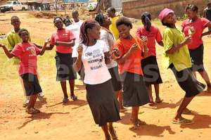 Formerly abused children dance at the launch of Sauti.