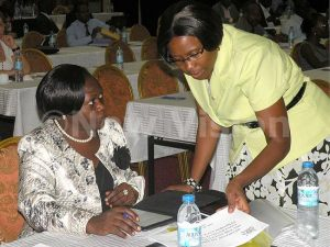 Director General of Health service Jane Aceng (R) presents a health research report to the State minister for health (Primary care) Sarah Opendi at Imperial Royale Hotel.