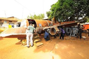 The prototype aircraft  is being assembled under a mango tree