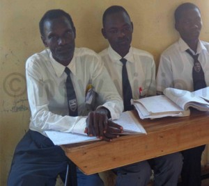 Adinga David Ojom in class with his fellow students at Dr. Obote College.