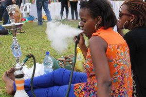 A woman smokes shisha at a recent social event. Shisha smoking is becoming a pleasure of youth. But MPs have resolved to ban it.