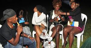 A group young people smoking shisha at a recent social event. Shisha smoking is increasingly becoming a pleasure of youth