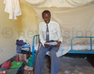 Ojom in the school dormitory after classes. His wife has claimed she lives like a widow because of his prolonged absence while he is schooling.