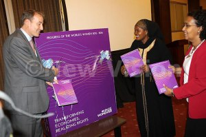The EU head of delegation Kristian Schmidit (left) launching the World's Women 2015-2016 Report at Serena Hotel. Looking on are State minister Rukia Nakadama (center) and UN Country representative Hodan Addou.