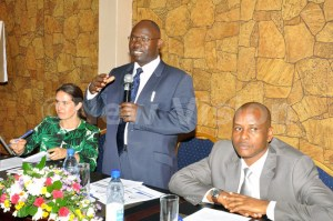 The executive director of Foundation for Human Rights Initiative, Livingstone Sewanyana (C), the programme officer Penal Reform International Olivia Rope (L) and the assistant registrar of High Court, Jamson Karemani addressing participants during the release of a survey on who are women prisoners in Uganda at Hotel Africana in Kampala.