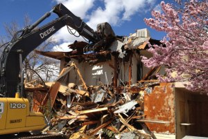 A house being demolished following a land wrangle. This destruction of property is common when land is under dispute.