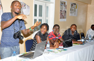 A social media blogger, Sam Bannz, explains the impact of social media during media and sexuality training at Eureka Place Hotel in Kampala on Friday Sept 4, 2015.